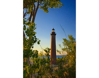 Little Sable Point Lighthouse through the trees on the Lake Michigan Shore by Silver Lake Michigan No.524 - A Lighthouse Seascape Photograph