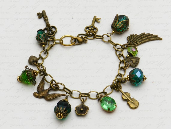 Green Charm Bracelet with faceted glass beads, bead caps, and brass charms  JF6033