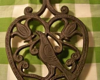 Vintage Cast Iron Folk Art Trivet