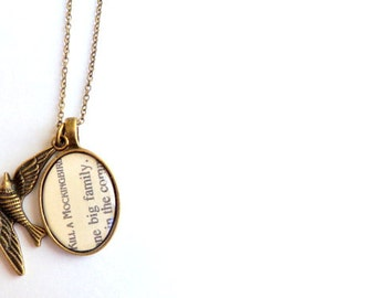 """To Kill A Mockingbird Necklace. Vintage Bookpage. """"One Big Family""""."""