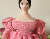 Vintage hand carved primitive doll by Sally Gavney doll artist in pink calico dress with petticoat and straw hat