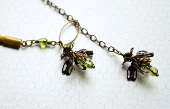 Firefly Necklace in brass and olive green Czech glass with front clasp