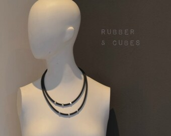 Beaded rubber necklace with silver plated cubes Dutch Design model Hope