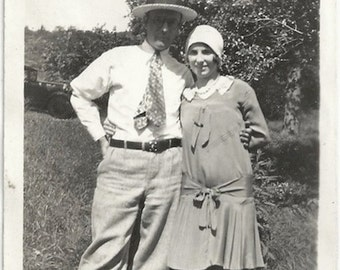 Old Photo Couple Outside Woman Wearing Dress Hat Man Knickers Boater Hat Tie Argyle Socks 1920s Photograph snapshot vintage