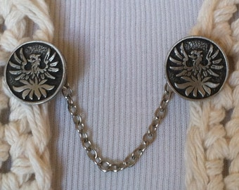 The mattie pewter phoenix sweater clip adds a touch of folklore to your wardrobe