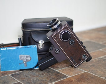 Vintage Kodak Instamatic M7 movie camera with case and Bobby Lee strap