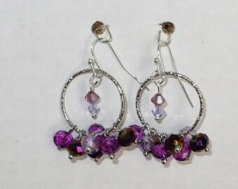 Hoop earrings with purple Czech crystals.