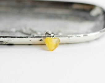Natural amber heart pendant