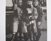 Llittle boys in top hats, holiday print ad, mischievous boys, Polaroid Land Camera, ad, prints to frame, cute kids, Dickens