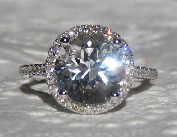 white topaz in white gold halo engagement ring