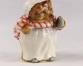 Beatrix Potter Beswick Mrs Tiggywinkle with Iron Figurine BP1a 1948 - 54 (Gold Circle)  8.5 cms high. Collectors item. Very Good Condition