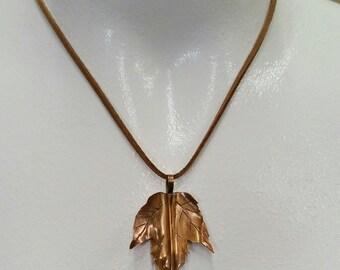 Fold formed copper leaf pendant