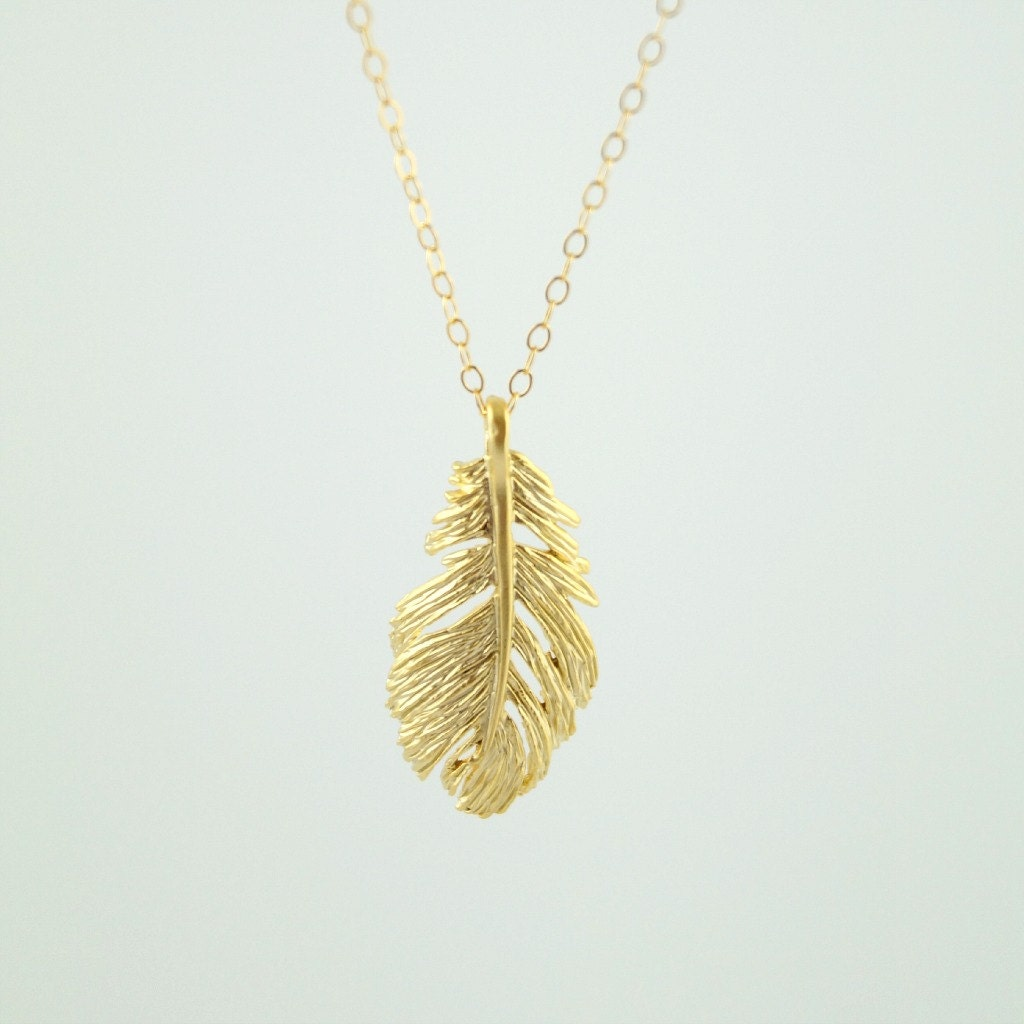 gold feather necklace gold necklace by wanderandlustjewelry