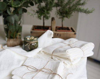 The set of tablecloth, 4 napkins and 2 tea towels in Washed soft White linen