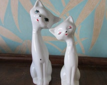Pair of vintage white ceramic cats sitting proud, cute bow tie detail