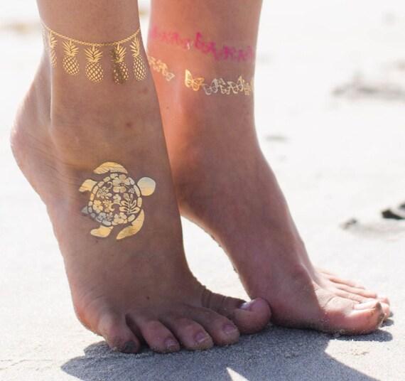 Výsledek obrázku pro metallic tattoo beach