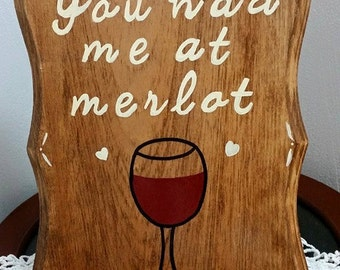 "Hand-painted ""You had me at merlot"" sign"