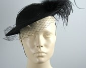 Vintage Ostrich Feather Hat in black with veil / netting