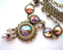 Pastel rhinestone filigree necklace, antiqued brass crown settings, multi colored crystal stones, pink crystal dangles, rhinestone jewelry