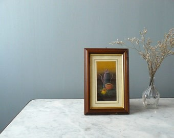 Vintage frame. still life painting. wooden frame. teapot cup and flower original painting