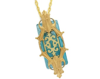 Steampunk Necklace Passages In Golden Brass with Escutcheon by Dr Brassy Steampunk Aquamarine Blue Glass and Art Deco Gold Brass