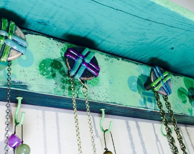 Pallet wood Wall shelf / bracelet holder recycled pallet wood shelf distressed teal, hunter green fleur de lis 7 hooks 6 hand-painted knobs