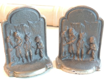 Antique Oliver Twist Cast Iron Book Ends