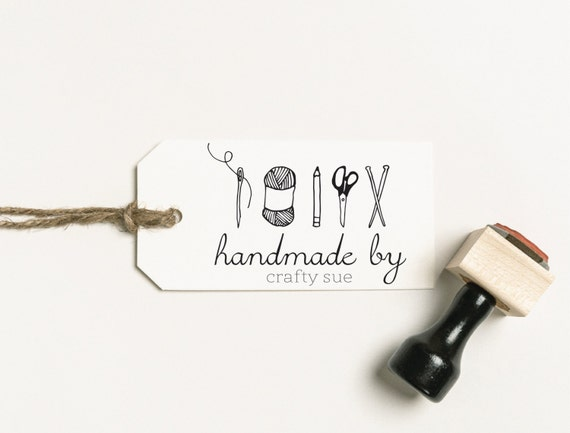 a label with text on it reading handmade by crafty sue next to a personalized stamp