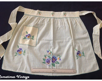 Vintage 1/2 apron. Yellow and white gingham. Cross stitched pansy with front pocket and green ric rac.