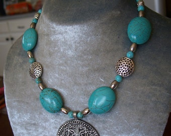 Turquoise and metal pendant necklace