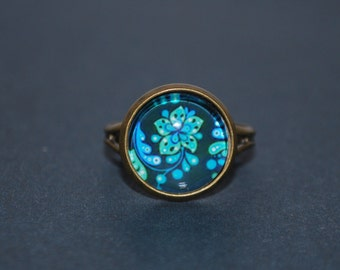 Adjustable ring - blue and green comic flower