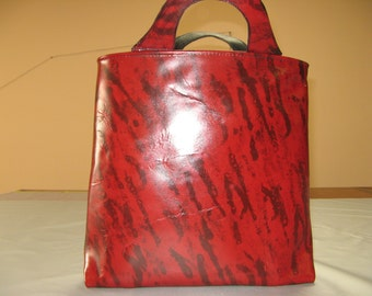 Red and black tiger striped leather tote.