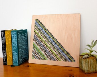 "Modern Cross Stitch, Laser Cut Birch Wall Hanging, 12"" x 12"", Triangle Pattern, Blues, Greens and Greys"
