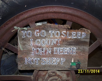 I count John Deere not sheep barn board sign