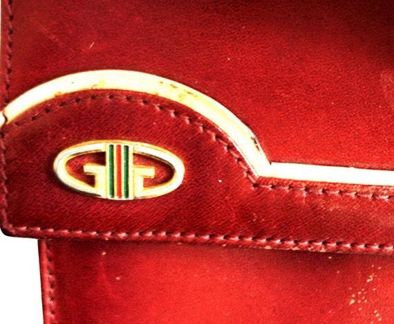 Etui de lunettes gucci rouge en cuir rare par mushkavintage3 for Change vos fenetre cas par cas logo