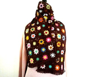 Scarf crochet granny multicolored flowers on dark maroon background