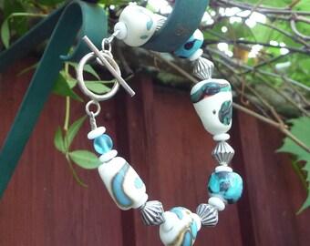 Blue, turquoise and white flamework bead  bracelet
