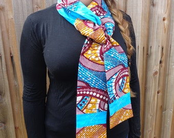 Handmade scarf out of African waxed fabric.