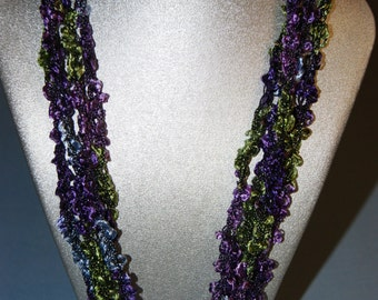 Beautiful, Mardi Gras  colors, lightweight crocheted necklace.  Adjustable length