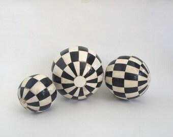 Bone black and white balls