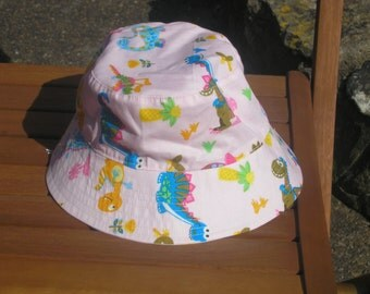 Reversible child's bucket hat - 100% cotton fabric - choose which side you want to wear today!