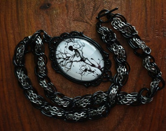 Mother and child skeleton cameo necklace