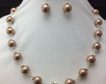 Pearl with rhinestone studded center bead
