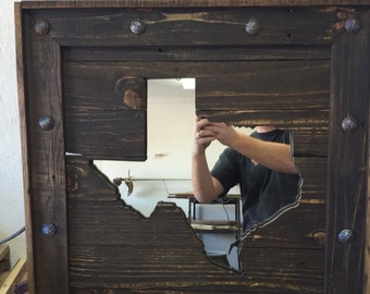 Texas reclaimed wood mirror with decorative gromets.