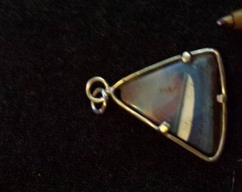 Australian boulder opal pendant set in sterling silver.