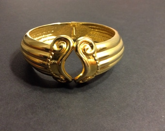 Gold Tone Greek style bangle with hinge
