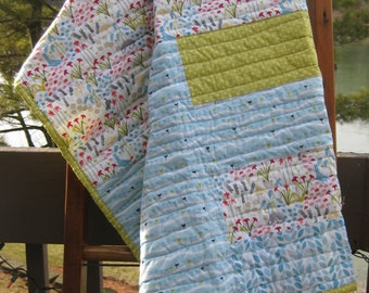 Blue, Green and Pink Strip Quilt.