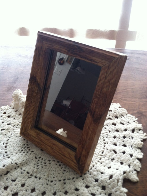 Nice small hanging mirror with a stained wooden by for Small hanging mirror