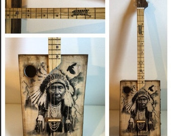 Acoustic cigar box guitar indian