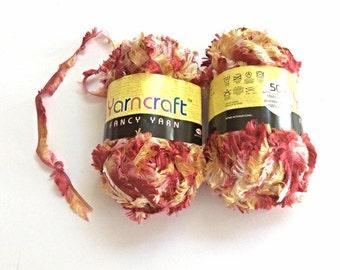 Eyelash yarn, mixed reds and yellows.  Autumn colours. 50g ball